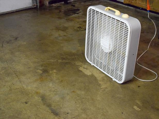 9Original_Dylan-Eastman_Garage-Floor-use-fans-to-dry.jpg.rend.hgtvcom.616.462