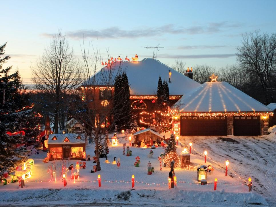 Colorful and outrageously themed outdoor christmas lights room with warm and cozy homes a rolling train nearby and elves busy at work this is certainly the most spirited place to be during the christmas season aloadofball Image collections