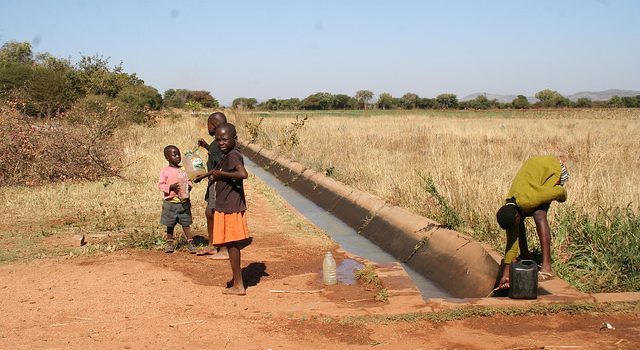 Children fetch water from a canal at the Magwe irrigation scheme in south Matabeleland, Zimbabwe. Credit: Busani Bafana/IPS
